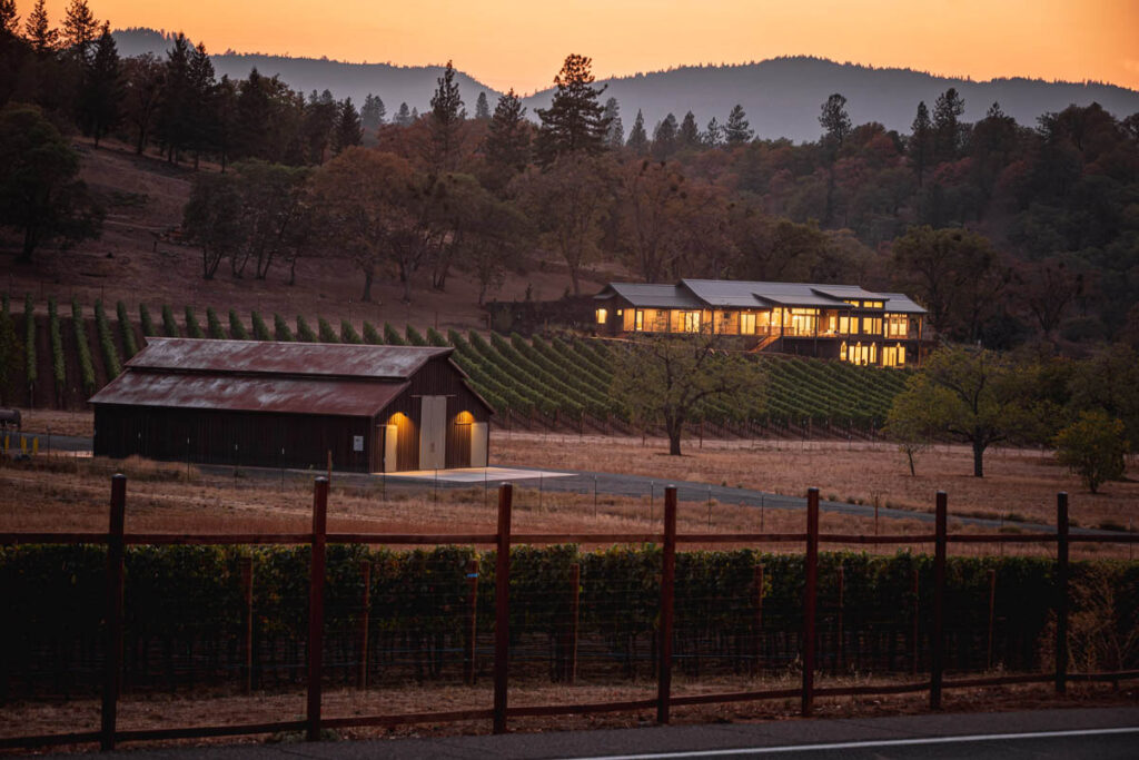 sunset over the vineyard house